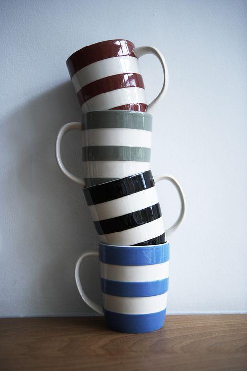 His mugs stacked